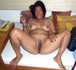 Totally naked asian MILF smokes after..